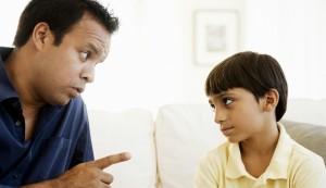Father correcting his son (610x351)