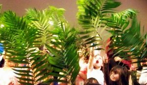 Children waving palms